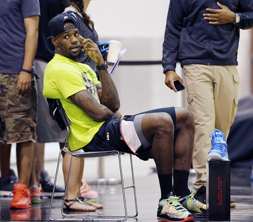 LeBron James speaks on a cellphone during the LeBron James Skills Academy in Las Vegas.