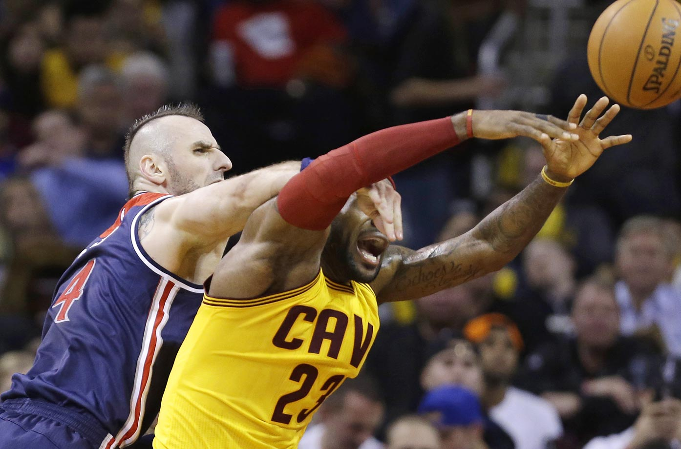 The Washington Wizards' Marcin Gortat fouls LeBron James during the Cavs' 113-87 win.