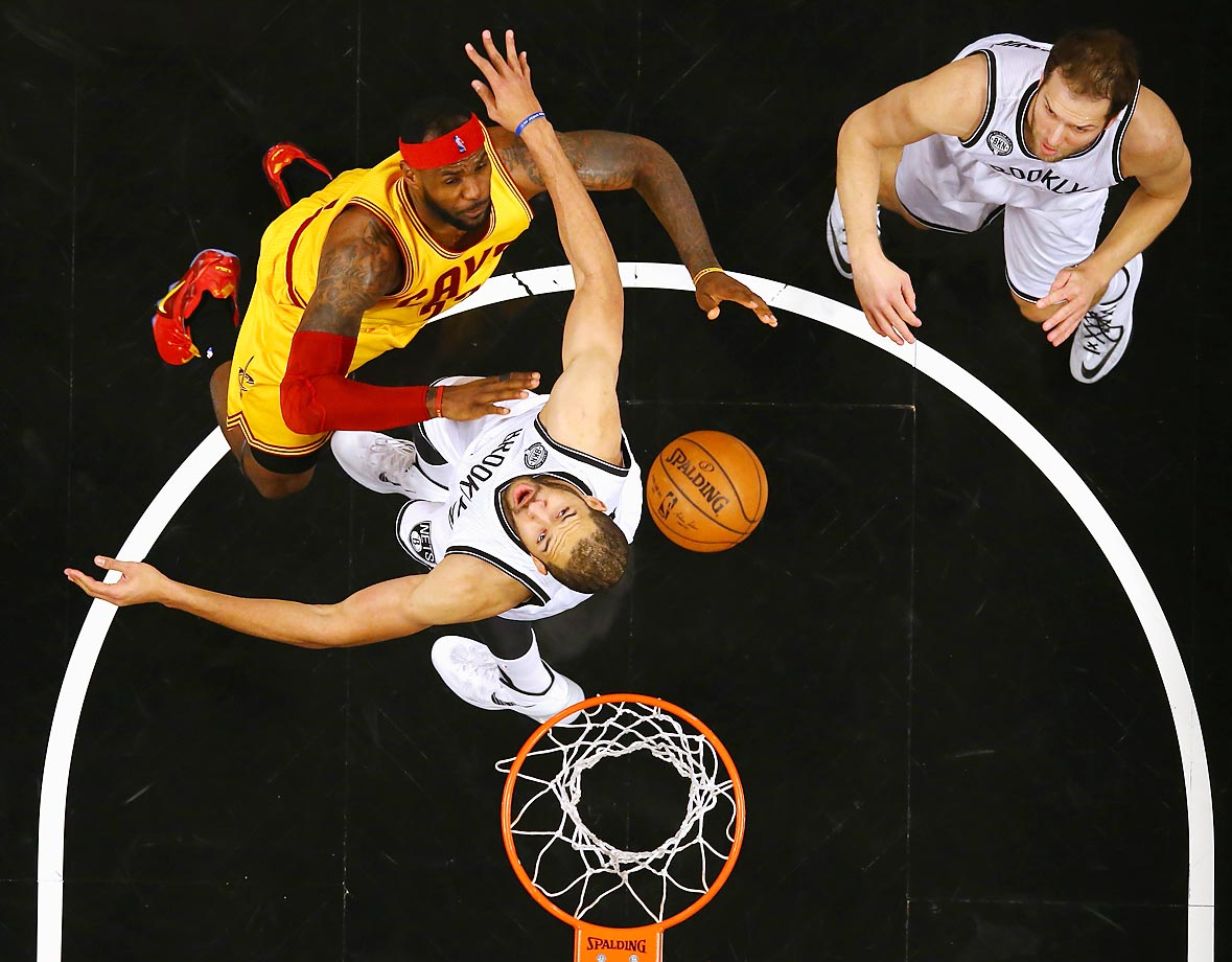 LeBron James battles Jerome Jordan and Bojan Bogdanovic of the Nets during their game at the Barclays Center.