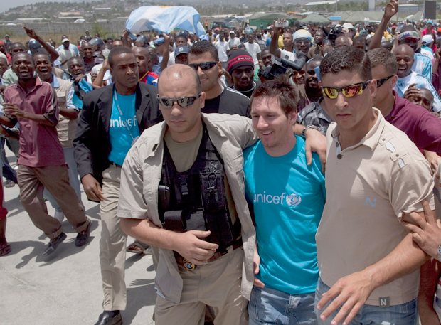 Messi visits an earthquake refugee camp in Port-au-Prince, Haiti. (AP)