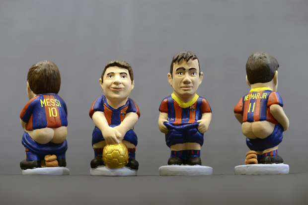 Ceramic figurines of Messi and Neymar. (Getty Images)
