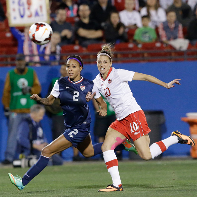U.S forward Sydney Leroux (2) and Canada defender Lauren Sesselmann (10) chase the ball during the first half of a soccer game Friday, Jan. 31, 2014, in Frisco, Texas. The United States won 1-0.