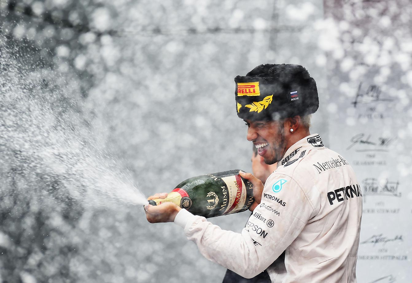 Lewis Hamilton celebrates after winning the Formula One Grand Prix of Russia.