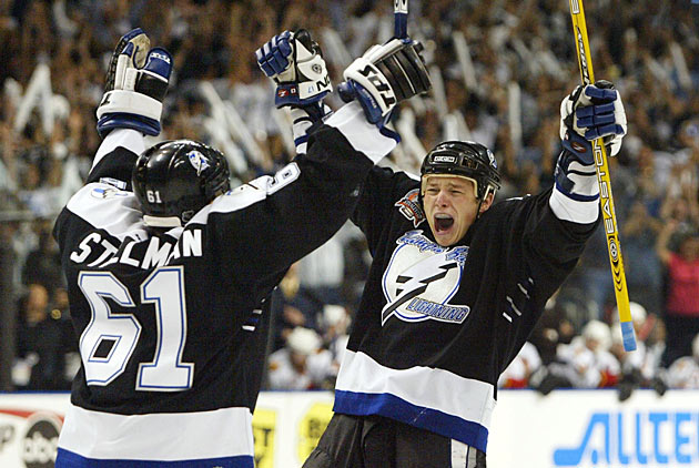Game 7 hero Ruslan Fedotenko (right) exulted after scoring the second of his two goals.
