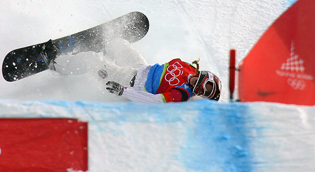 Lindsey Jacobellis falls to lose first place during the Ladies' Snowboard Cross final at the Turin Winter Olympics in 2006.