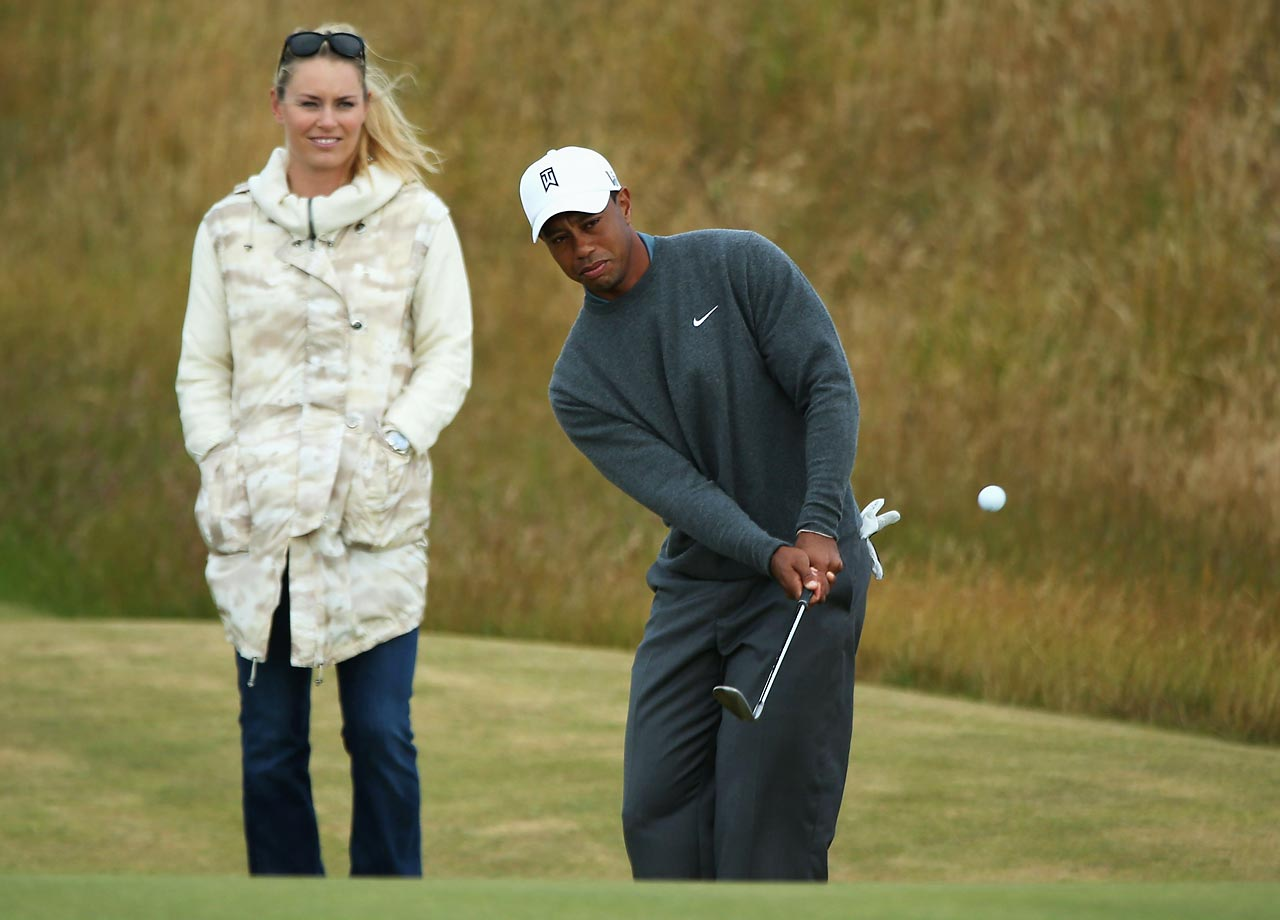 Vonn with Tiger Woods in Scotland on July 15, 2013.