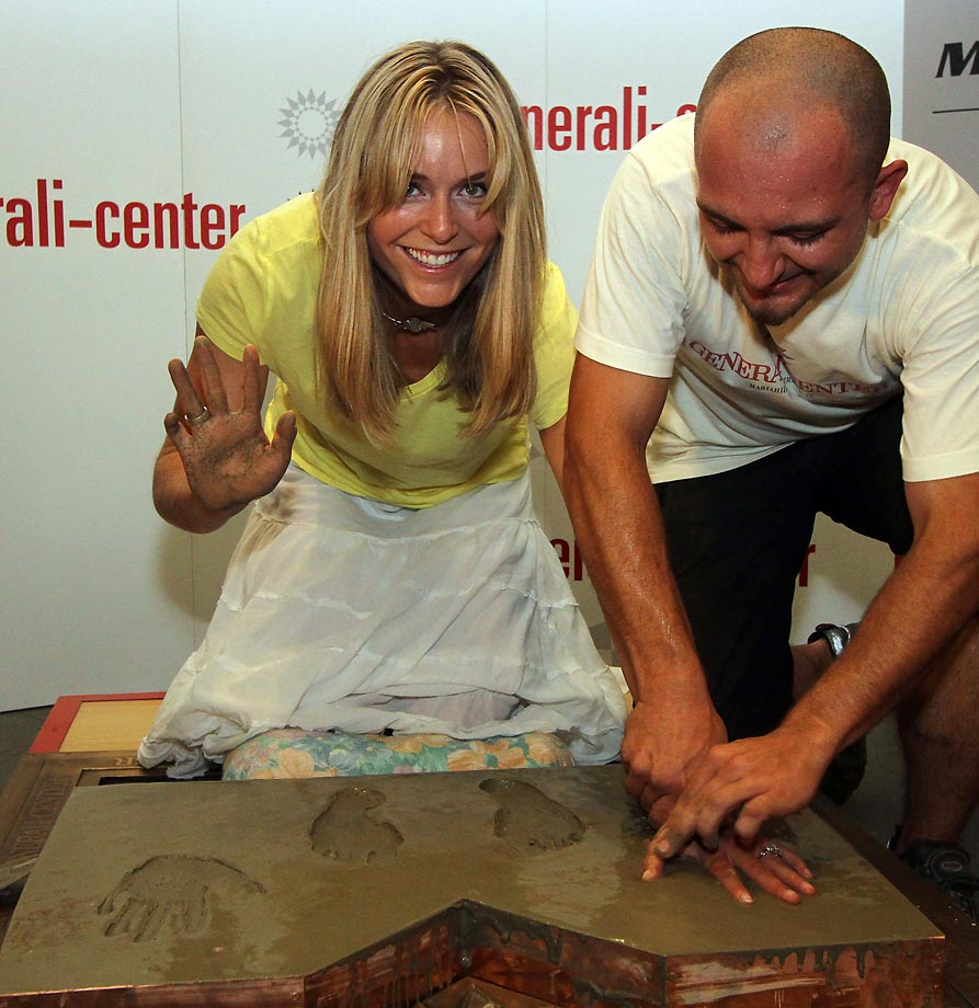 "Vonn pressing her hands and feet into concrete for the ""street of winners,"" which is part of a main shopping street in Vienna."
