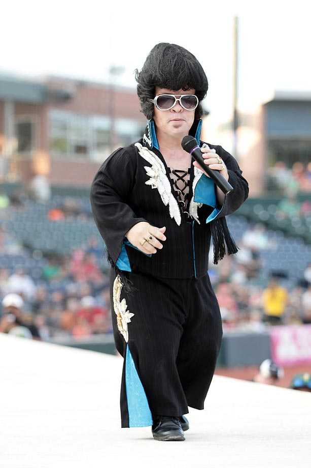 Little E, the Compact King of Rock n Roll, performed between innings at the Frontier League baseball game between the Rockford Aviators and the Normal CornBelters.