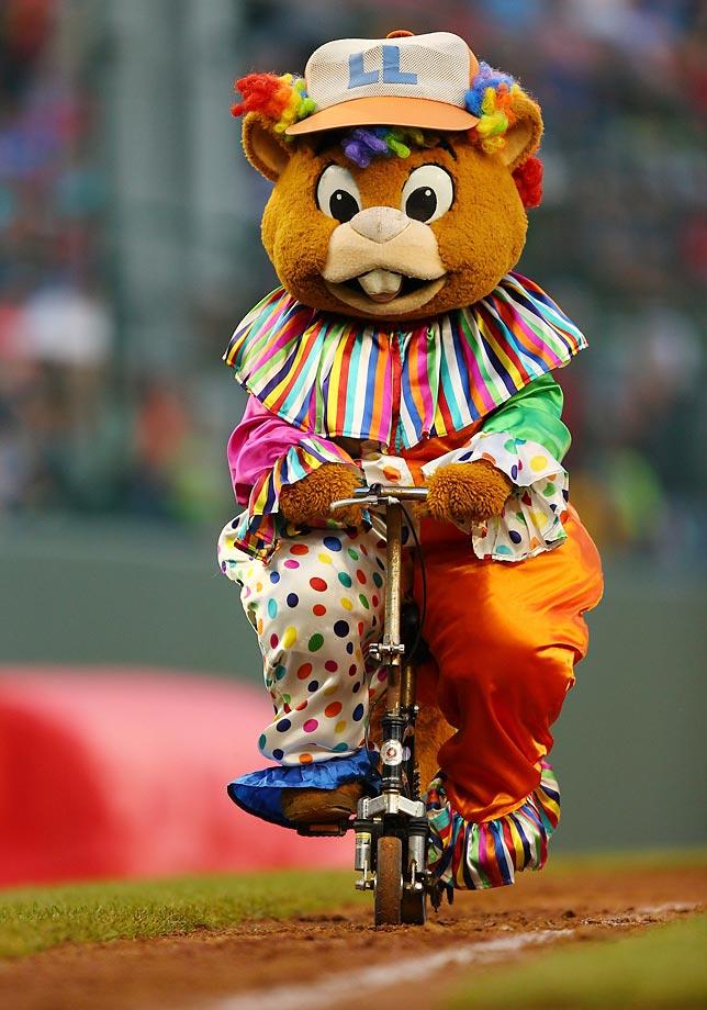 Dugout, the offical Little League World Series mascot, rides down the third base line.