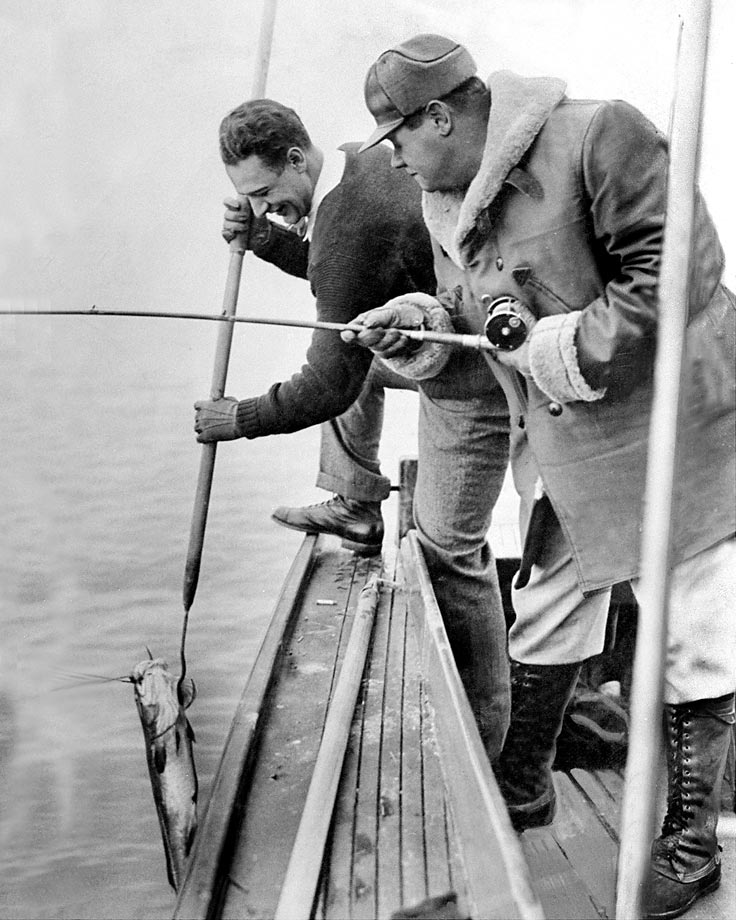 Lou Gehrig and Babe Ruth bag a fish in 1938.