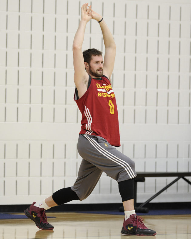 Cleveland Cavaliers forward Kevin Love stretches to loosen up his muscles prior to a team practice.
