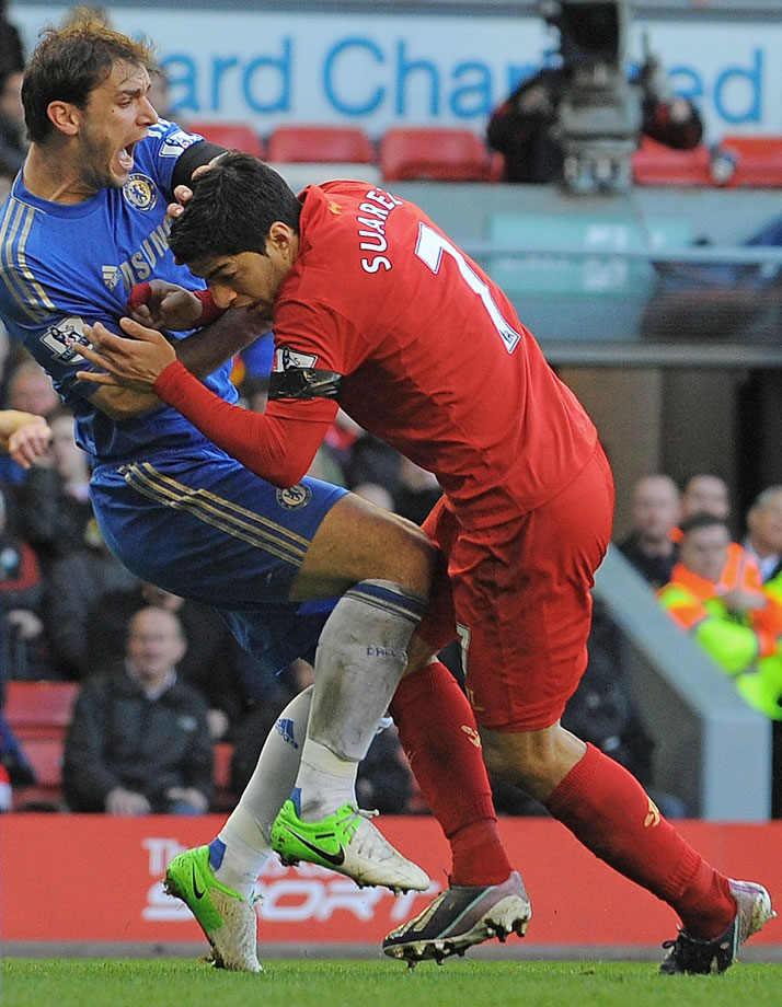 "Liverpool striker Luis Suarez of Uruguay bit Chelsea defender Branislav Ivanovic's arm during a Premier League match on April 21, 2013, before scoring his 30th goal of the season - a last-gasp equalizer - to clinch a 2-2 draw. ""For my unacceptable behavior yesterday, the club has fined me today,'' Suarez wrote on his Twitter and Facebook accounts. Suarez did not face a police investigation after Ivanovic said he did not want to press charges. ""He had no apparent physical injuries and did not wish to make a complaint,'' Merseyside Police said in a statement. Suarez was suspended for seven matches in 2010 while playing for Ajax after biting a player."