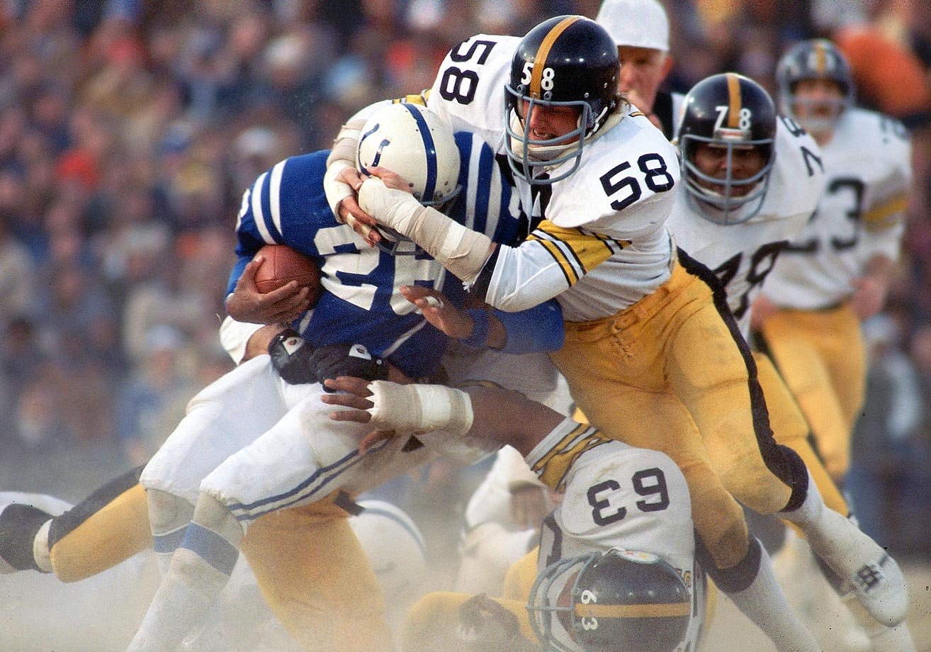 Lydell Mitchell of the Colts finds yardage tough to come by against Jack Lambert of the Pittsburgh Steelers in a December 1976 contest.