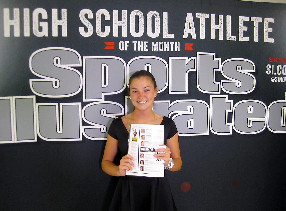 Maddy poses with her issue of SI.