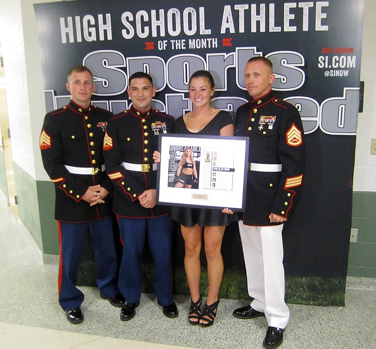 Members of the U.S. Marine Corps congratulate Maddy on her award as she heads off to attend Penn State after graduation.