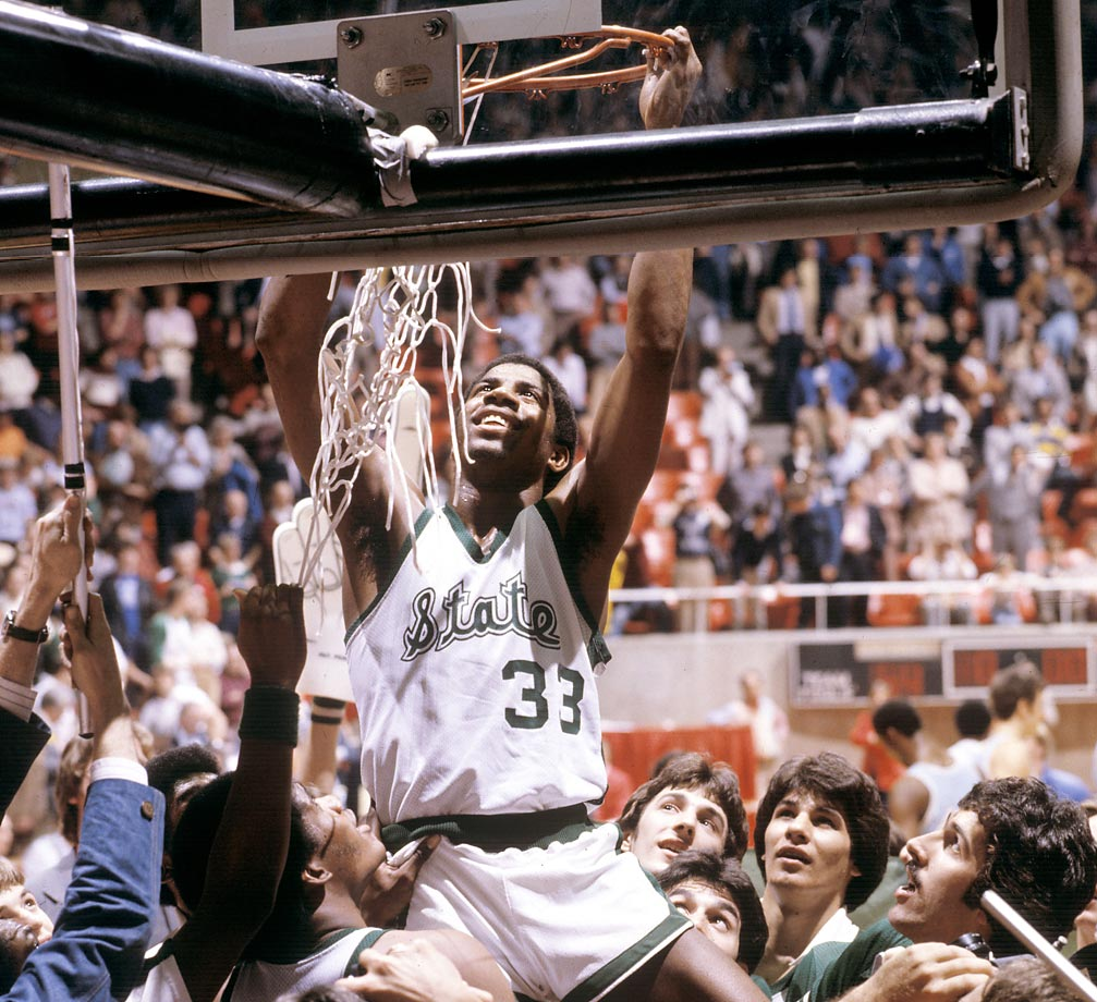 "Michigan State guard Earvin ""Magic"" Johnson cuts down the net after the title game. Johnson was named Most Outstanding Player in the 75-64 victory."