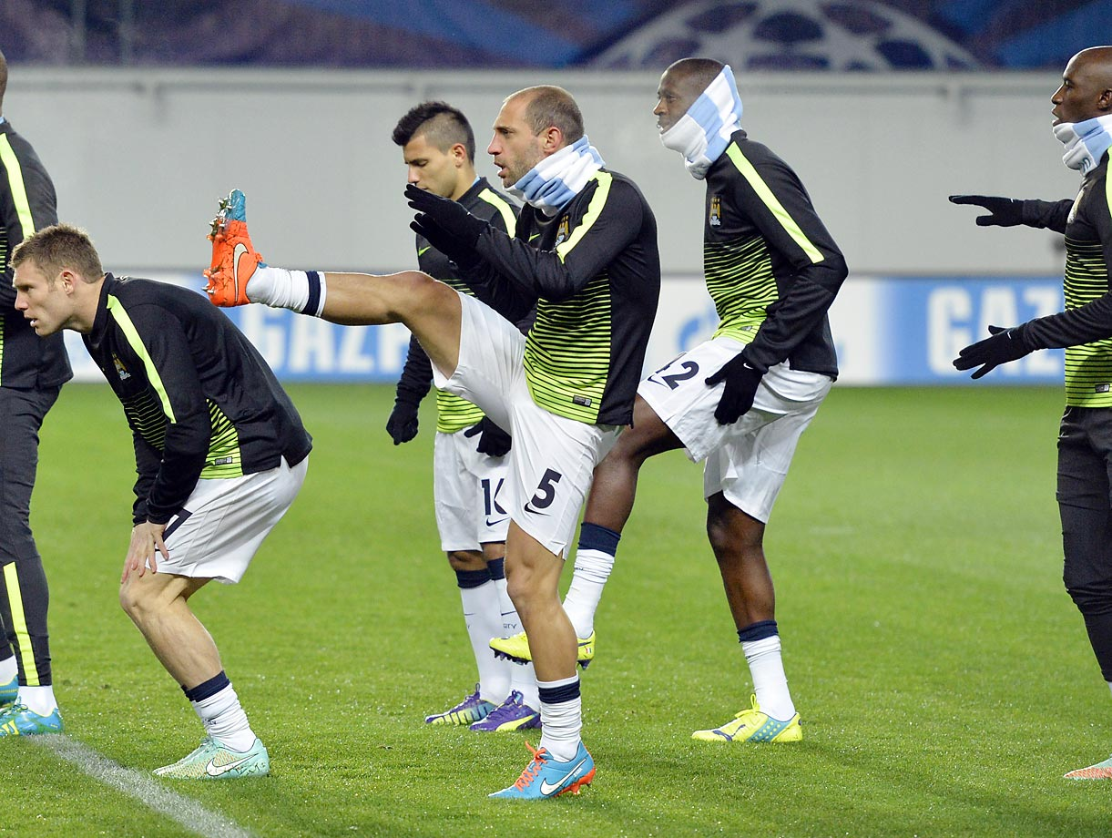 Manchester City's players warm up before the UEFA Champions League group E football match between CSKA Moscow and Manchester City at the Khimki Arena in Moscow.
