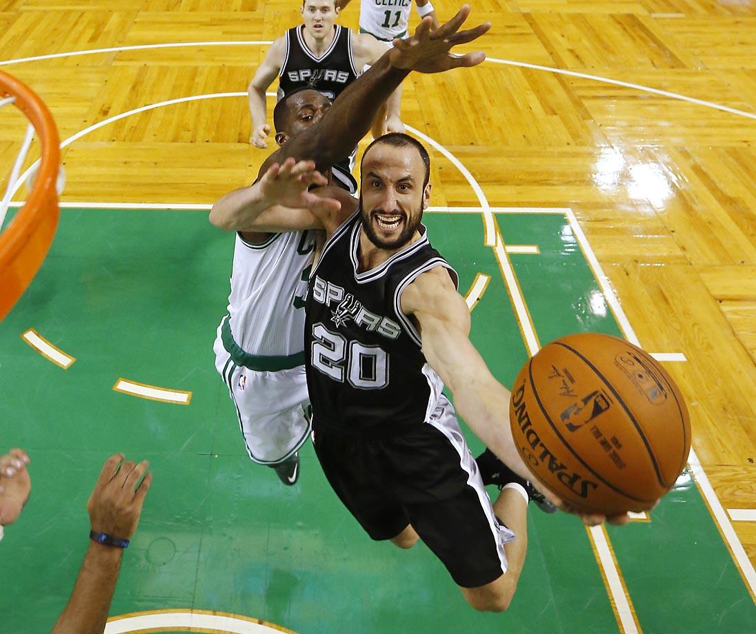 The San Antonio Spurs' Manu Ginobili drives past the Boston Celtics' Brandon Bass during San Antonio's 111-89 win.