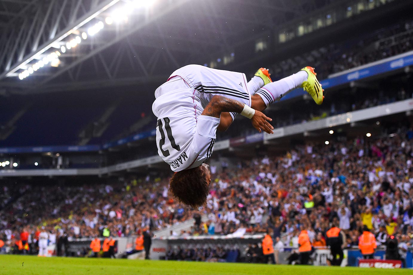 Marcelo Vieira of Real Madrid CF flips after scoring the fourth goal against Cornella.