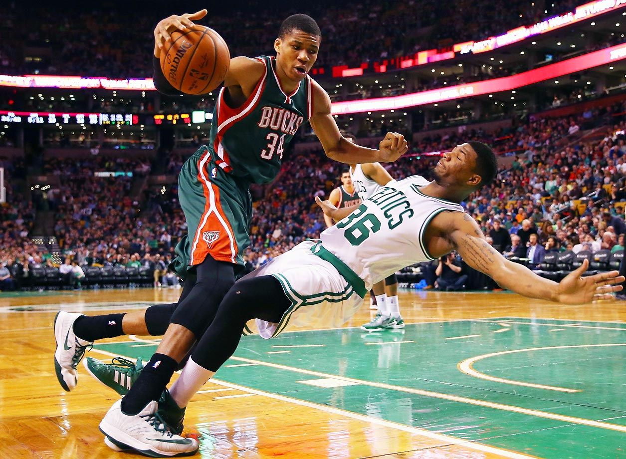 Marcus Smart of the Celtics is called for a charge against Giannis Antetokounmpo of the Bucks.