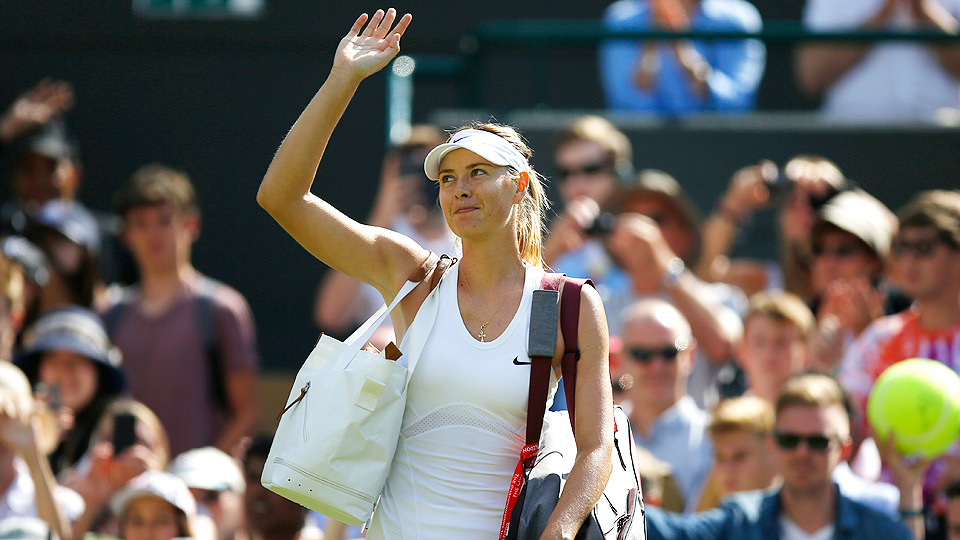 Maria Sharapova acknowledges the crowd after beating Samantha Murray in her first-round match at Wimbledon.