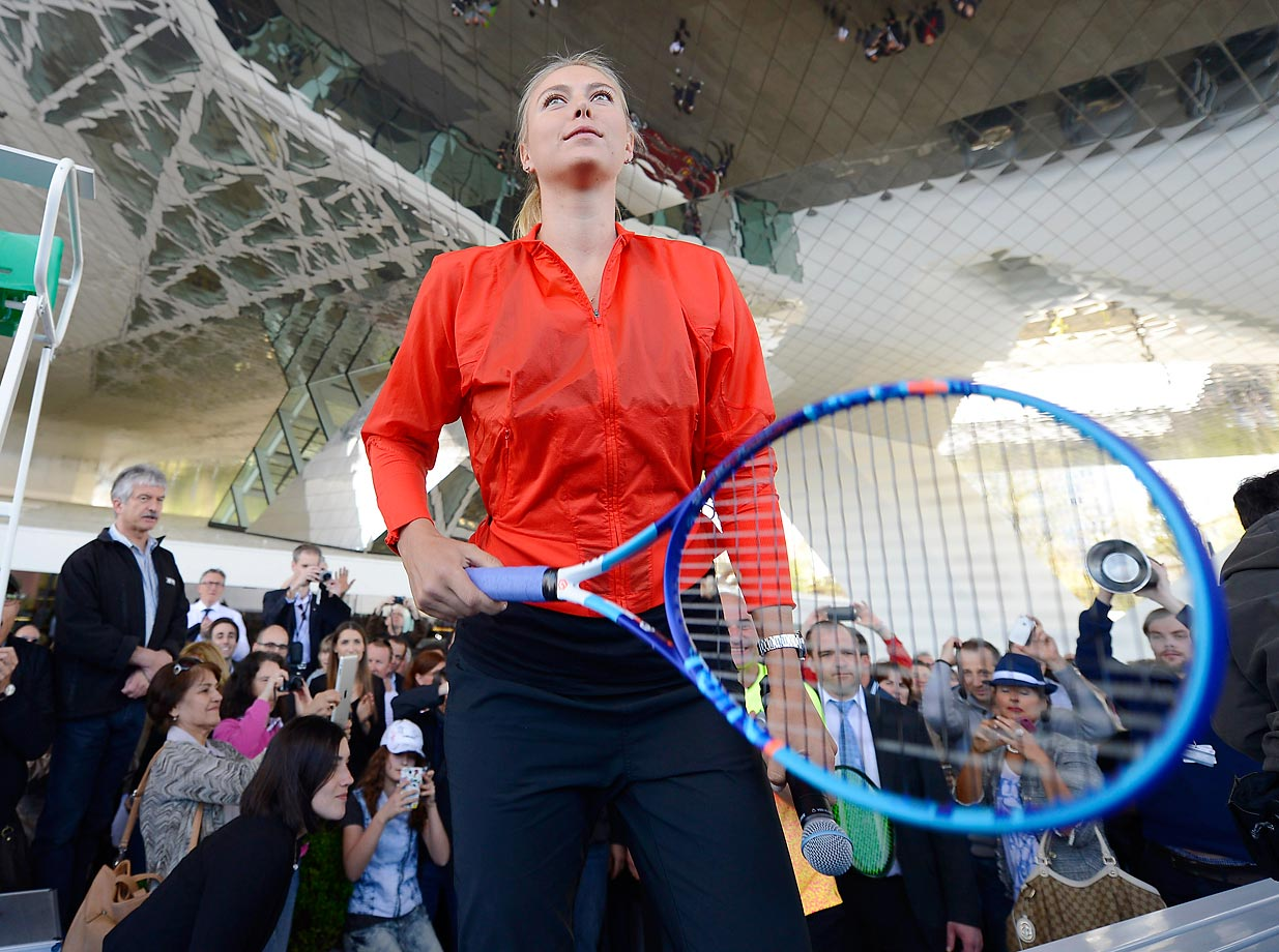 Maria Sharapova gets ready for the show match against Andre Agassi at the Porsche Grand Prix in Germany.