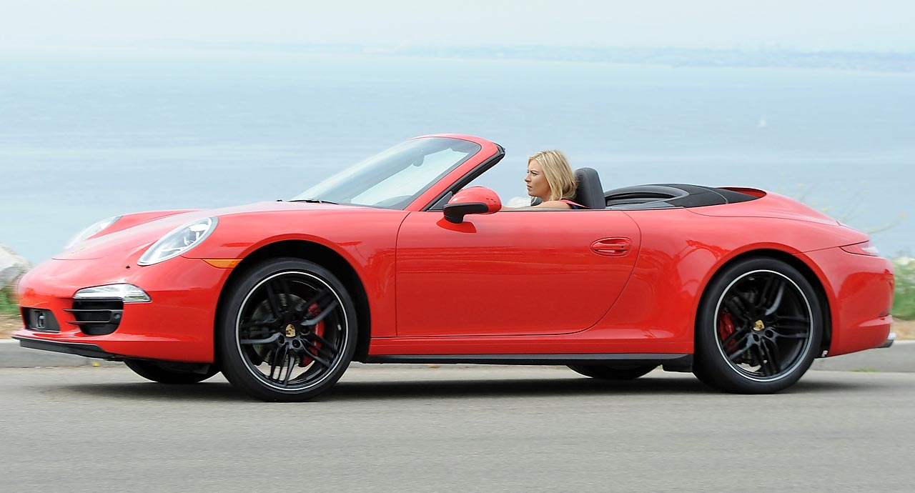 Maria Sharapova posing in this bright red Porsche during a photo shoot on July 11, 2013, in California.