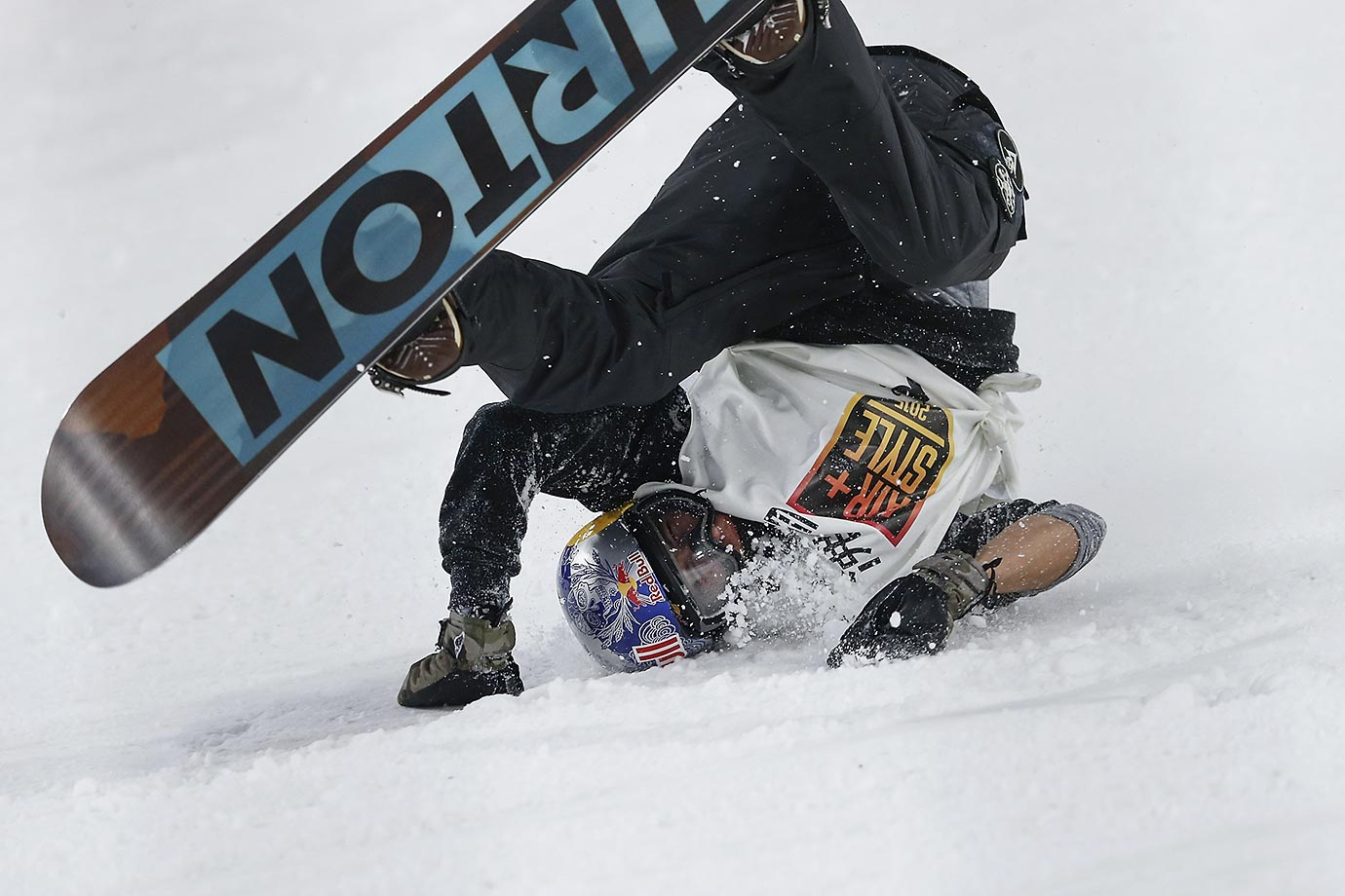 Mark McMorris crashes in his super final run during the Air-Style Beijing 2015 Snowboard World Cup.