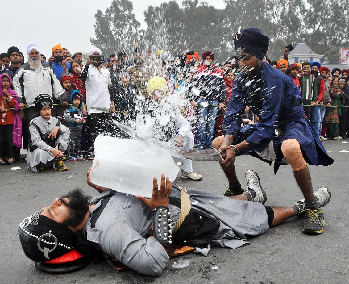 Indian Sikh devotees perform Gatka  - traditional Sikh martial arts - during Nagar Kirtan.