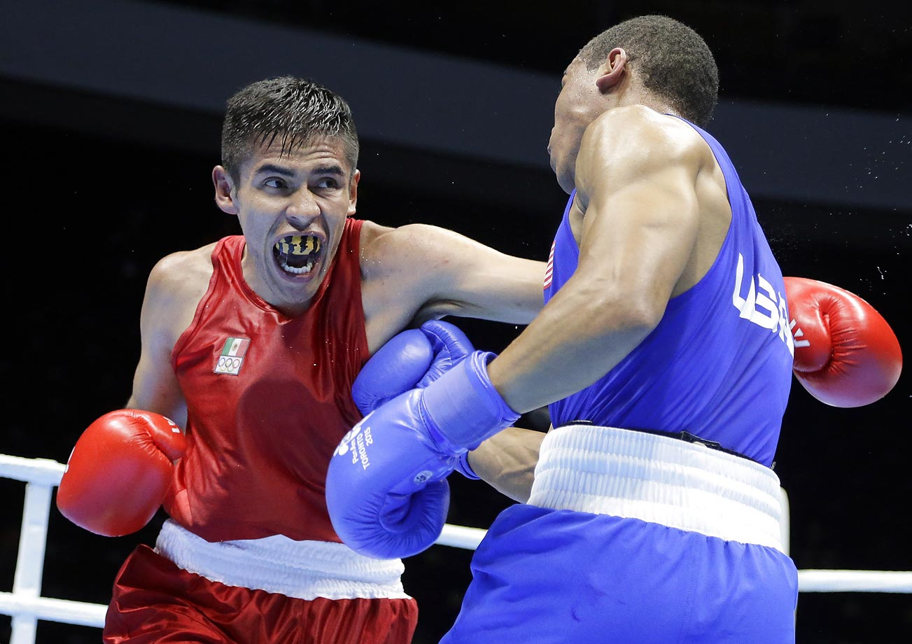 Marvin Cabrera, left, fights Brian Ceballo in a preliminary welterweight bout at the Pan Am Games.