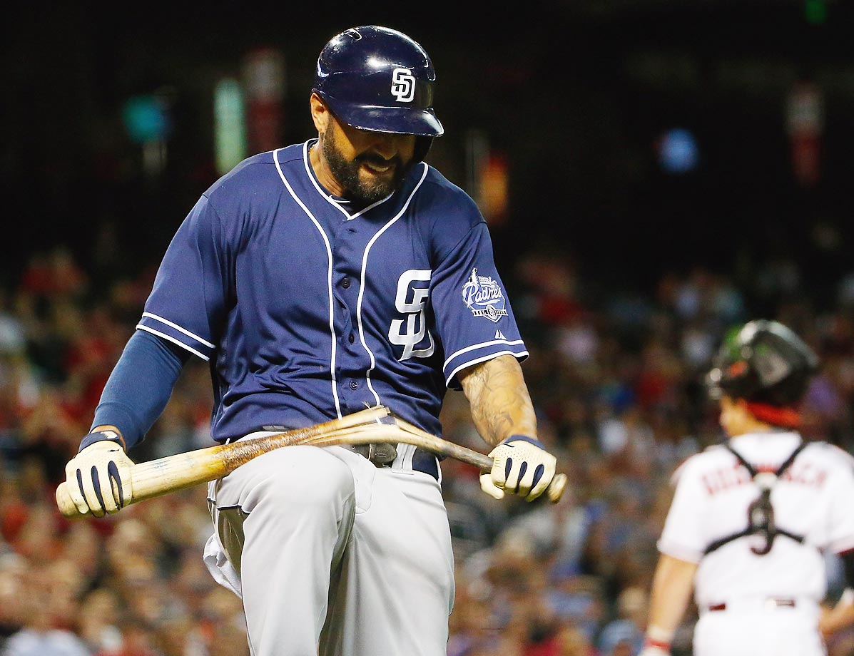 Matt Kemp of the Padres breaks his bat after fouling a ball off against the Diamondbacks.