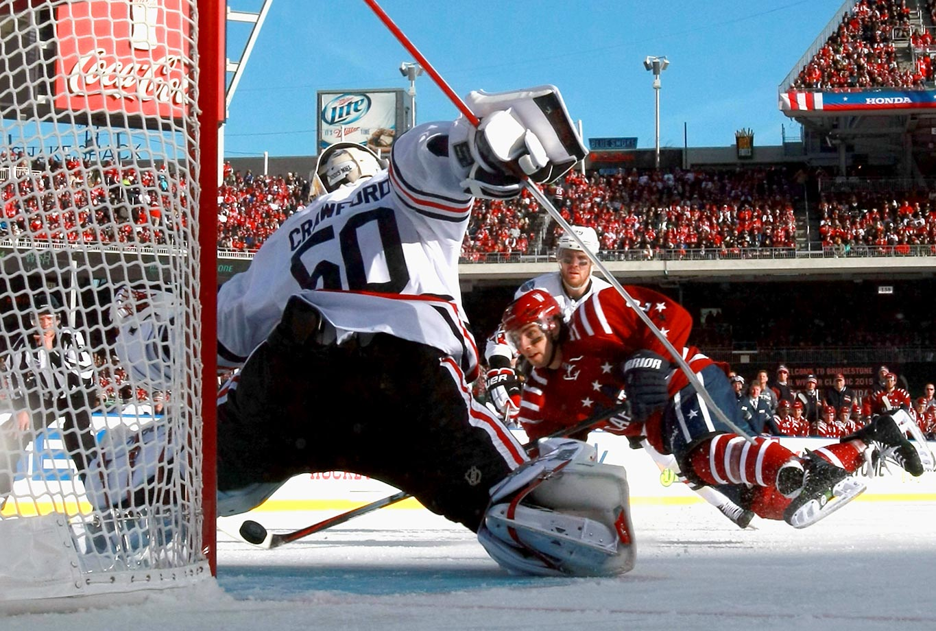 Matt Niskanen #2 of the Washington Capitals follows through on a shot on goal against goaltender Corey Crawford #50 of the Chicago Blackhawks during second period of the 2015 Bridgestone NHL Winter Classic on January 1, 2015 in Washington, DC.