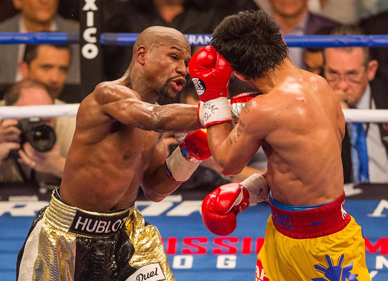 The long-awaited mega fight between Floyd Mayweather and Manny Pacquiao finally played out on May 2 with a star-studded crowd in Las Vegas that included the likes of Michael Jordan and Beyonce. Mayweather won easily via a unanimous decision, running his undefeated record to 48–0 and earning at least $100 million from the richest purse in boxing history.                                          (Text credit: Alex Putterman/SI.com)