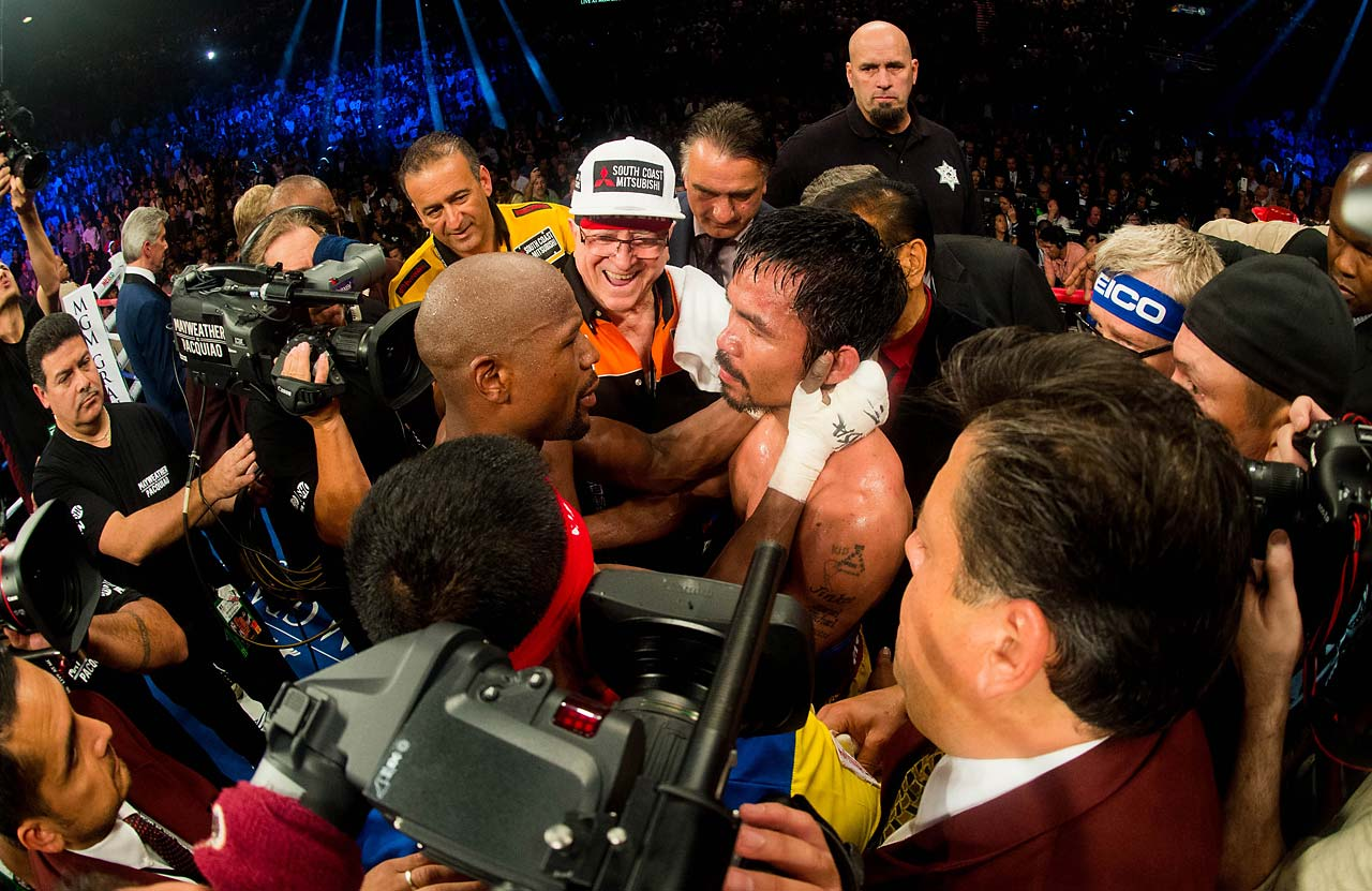 """You're tough,"" Mayweather said to Pacquiao after the bout, hugging him in the ring. (AP)"
