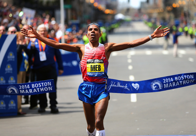 Meb crosses the finish line to win first place in the men's race of the 118th Boston Marathon.