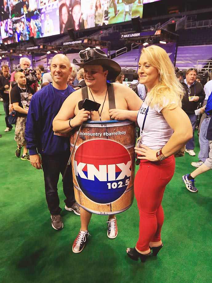 A media member from KNIX poses for a photo at Super Bowl XLIX Media Day.