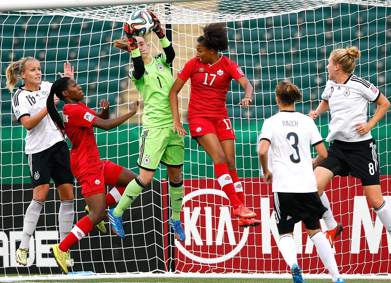 Goalkeeper Meike Kaemper of Germany saves a shot against Canada during the FIFA U-20 World Cup Canada 2014.