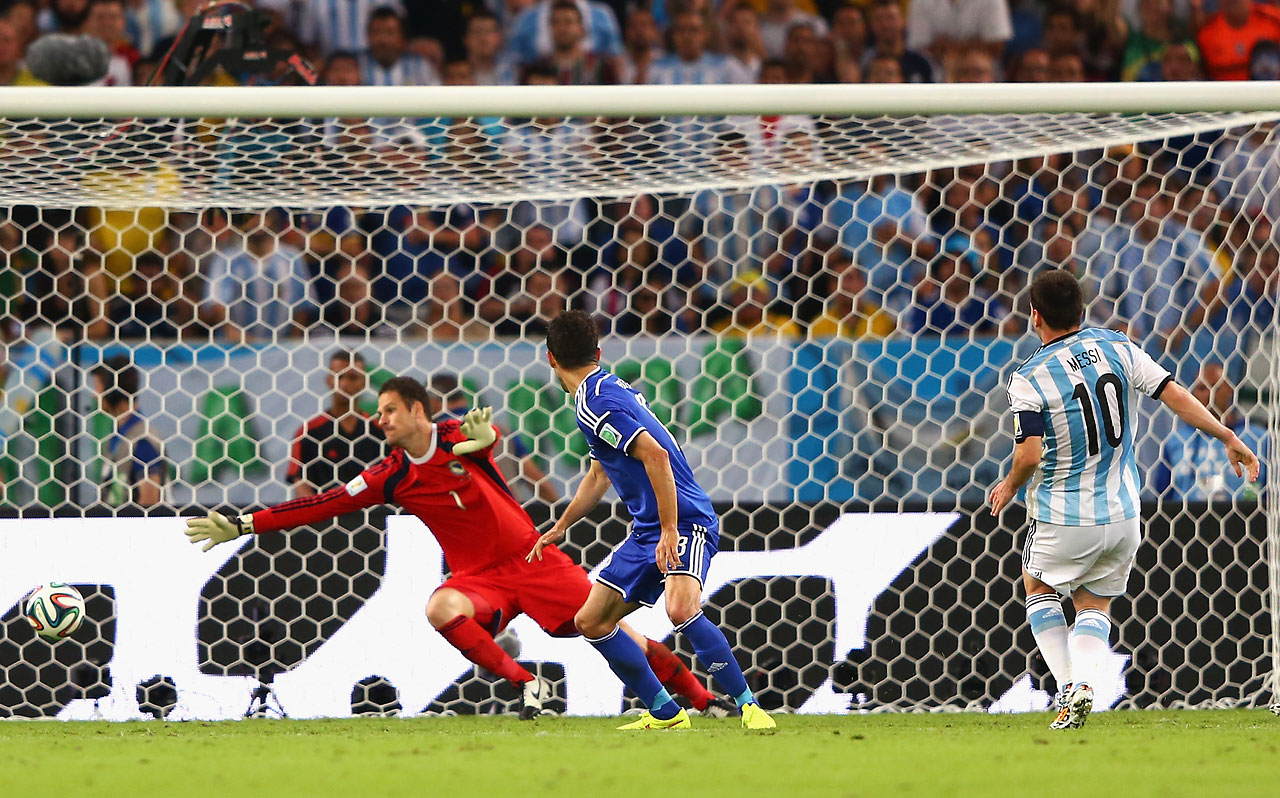 Lionel Messi of Argentina shoots and scores his team's second goal against Bosnia-Herzegovina at Maracana on June 15 in Rio de Janeiro.