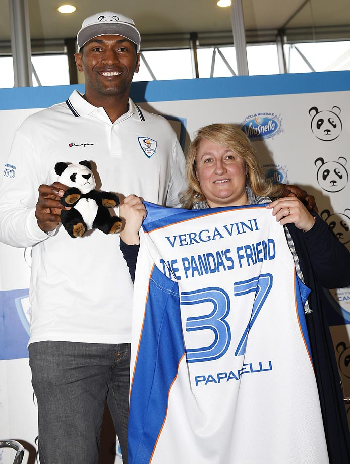 Former NBA star Metta World Peace poses with Anna Cremascoli, president of the Pallacanestro Cantu' team, prior to a press conference in Milan. Metta World Peace has signed with the Italian team  for the remainder of the season.