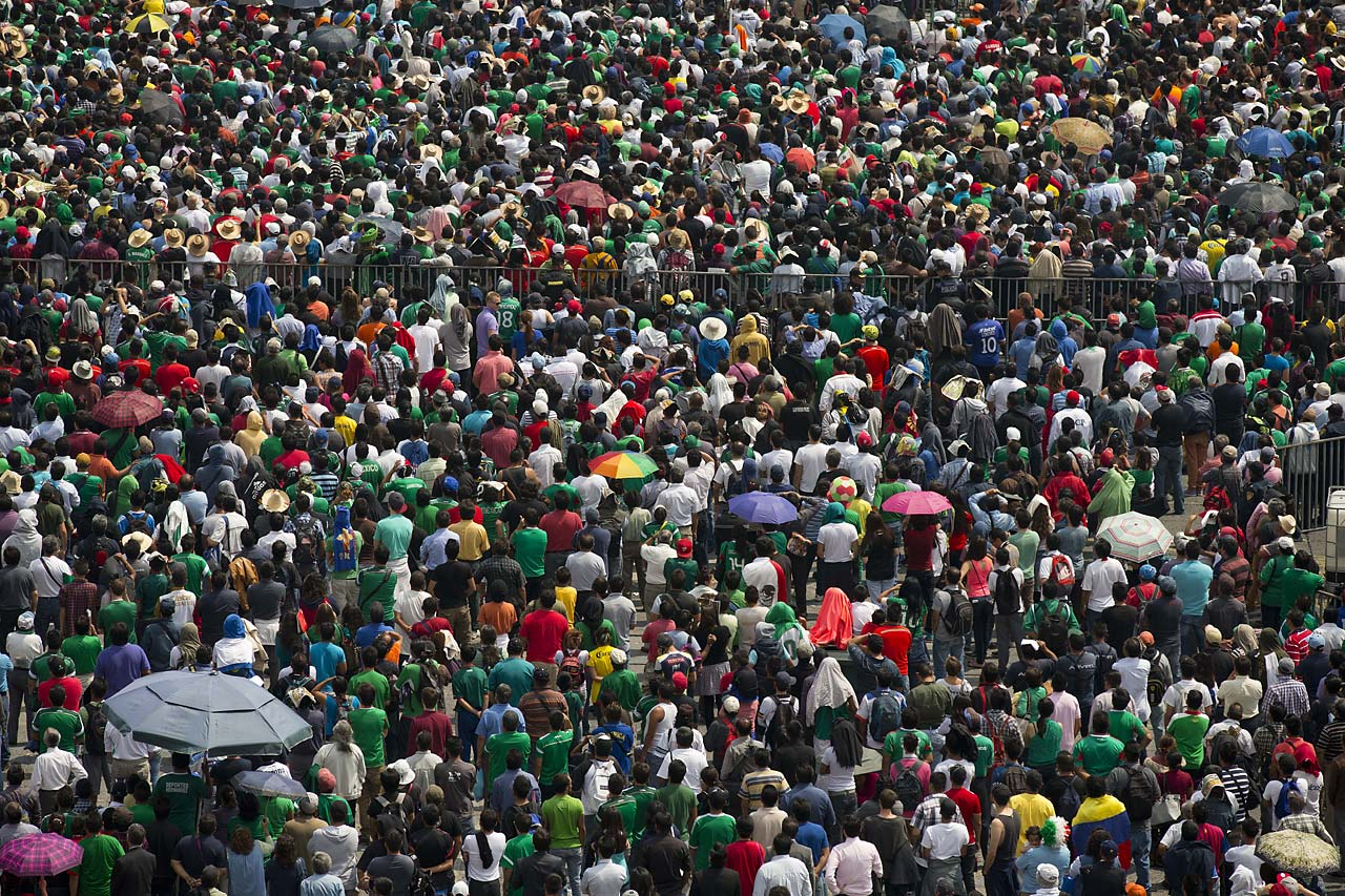 People in Mexico City's main square, the Zocalo, watch the match between El Tri and Cameroon.