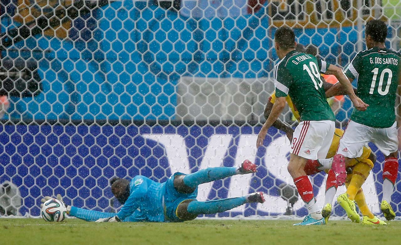 Mexico's Oribe Peralta follows up to score the only goal in Mexico's 1-0 victory over Cameroon in the Arena das Dunas in Natal on June 13.