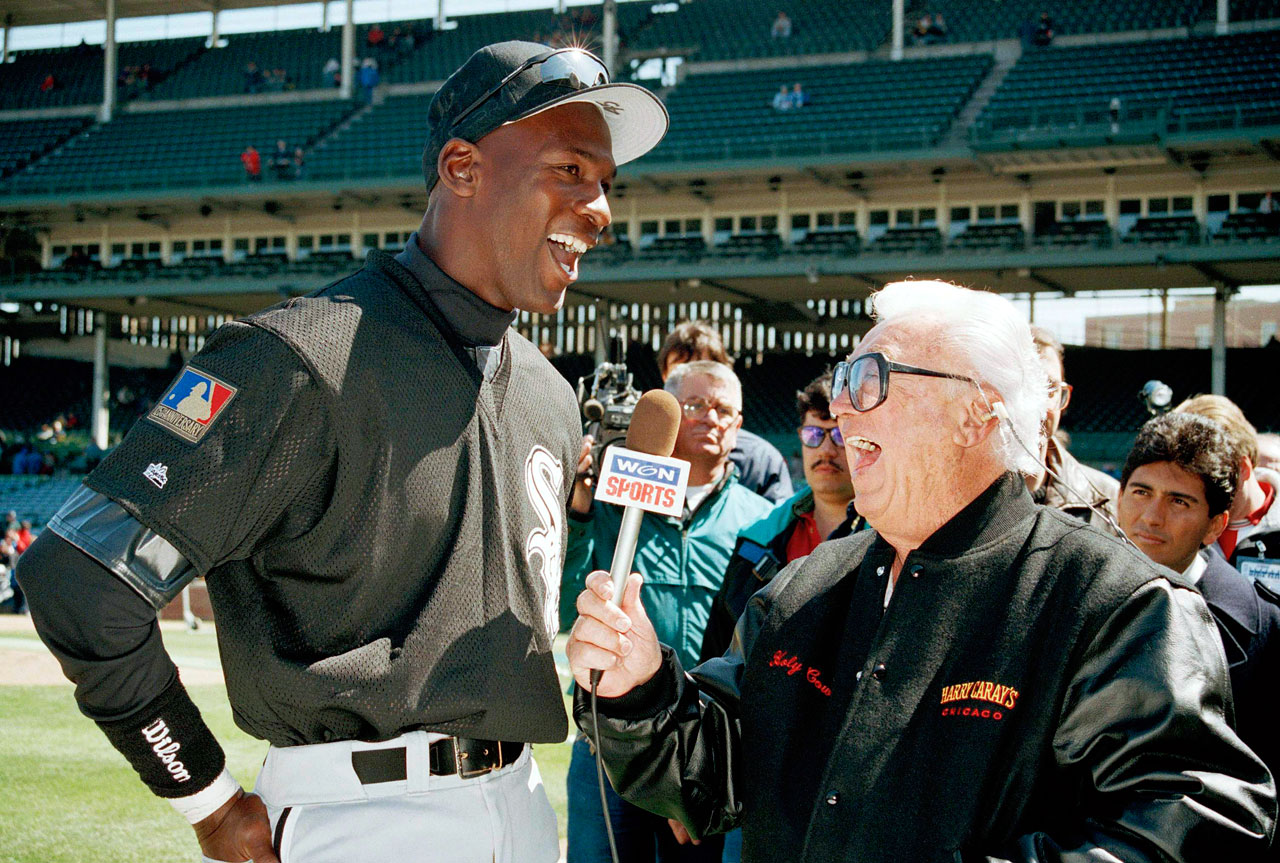 Harry Caray interviews Michael Jordan before the start of the 10th annual Crosstown Classic charity game between the White Sox and Chicago Cubs at Wrigley Field on April 7, 1994.
