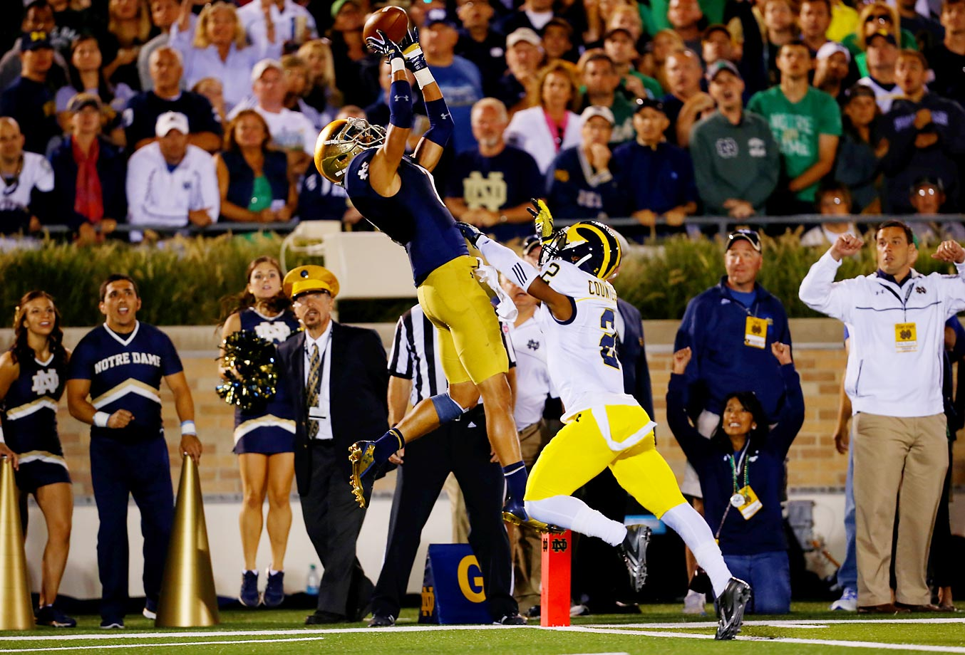 Notre Dame's receiver William Fuller catches a touchdown pass in front of Michigan's Blake Countess.