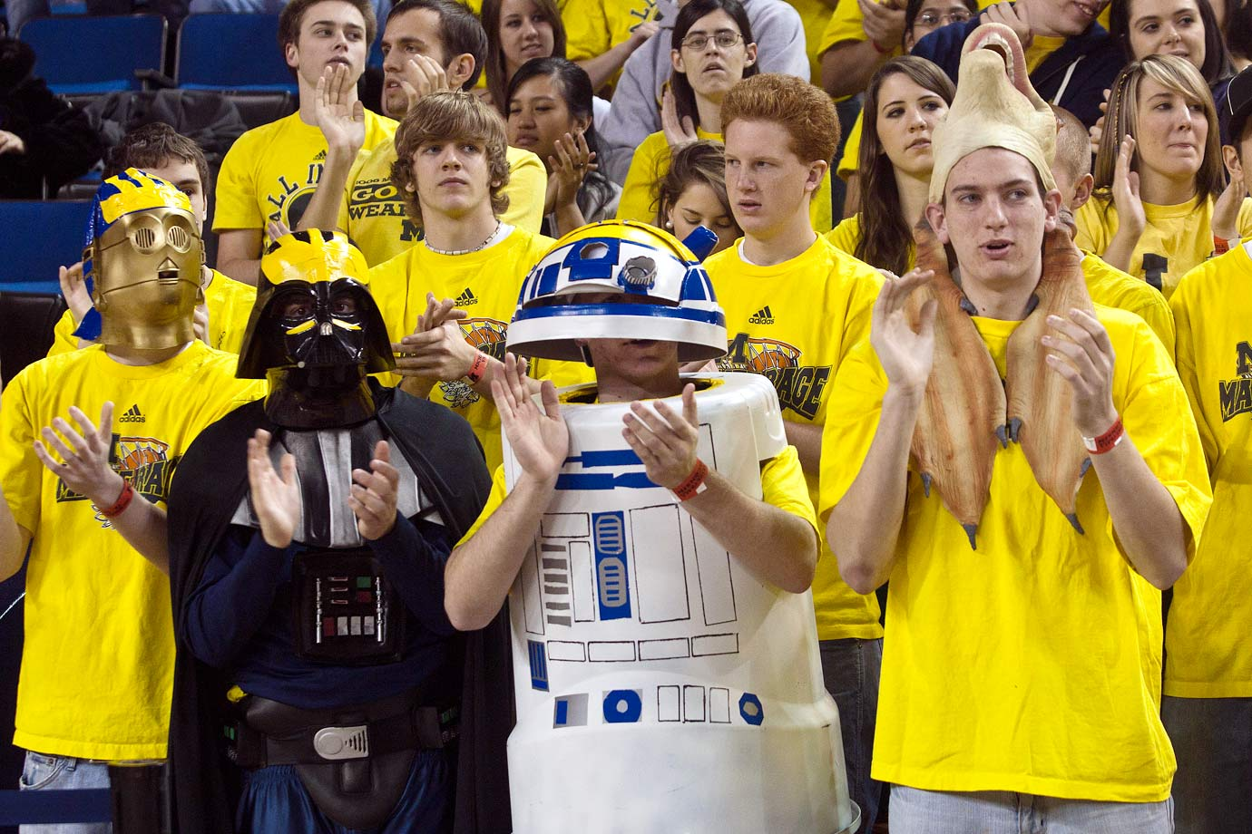 "Michigan fans in the ""Maize Rage"" student section dress as Star Wars characters during the team's basketball game against Wisconsin on Feb. 6, 2010 at Crisler Arena in Ann Arbor, Michigan."