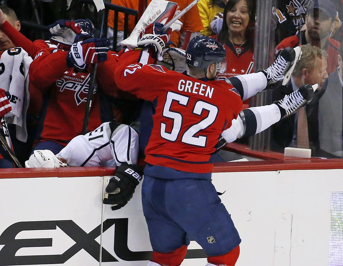 This time, Mike Green checks Kyle Clifford into the Capitals bench.