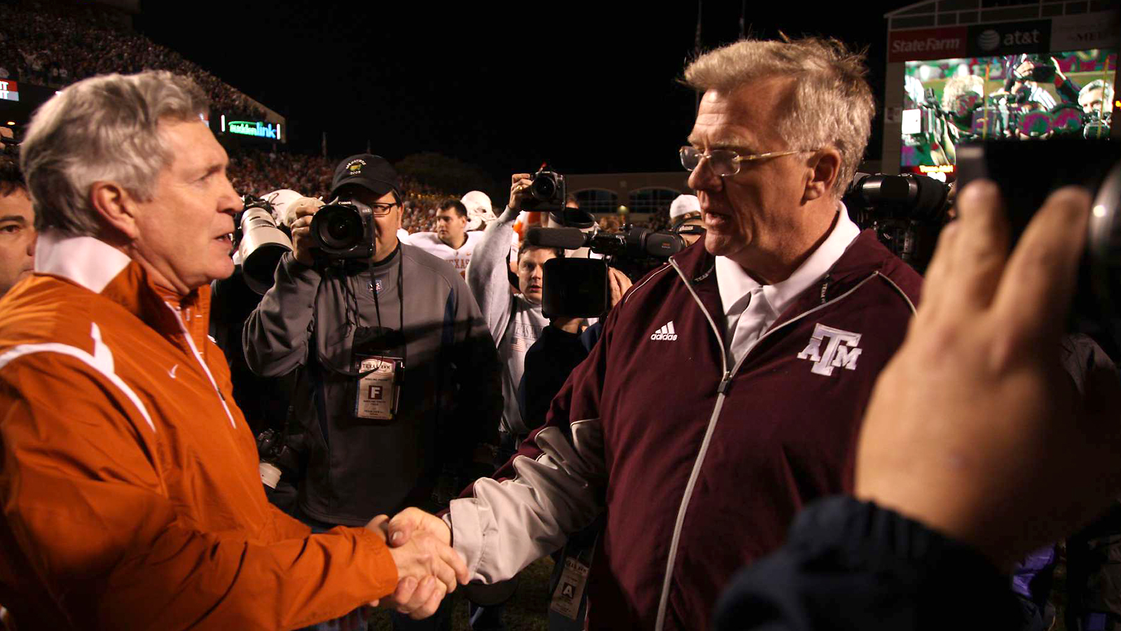 Congratulating Mack Brown after Texas's 49-39 win over Sherman's Texas A&M Aggies in November 2009. (Photo: Darren Carroll for Sports Illustrated)