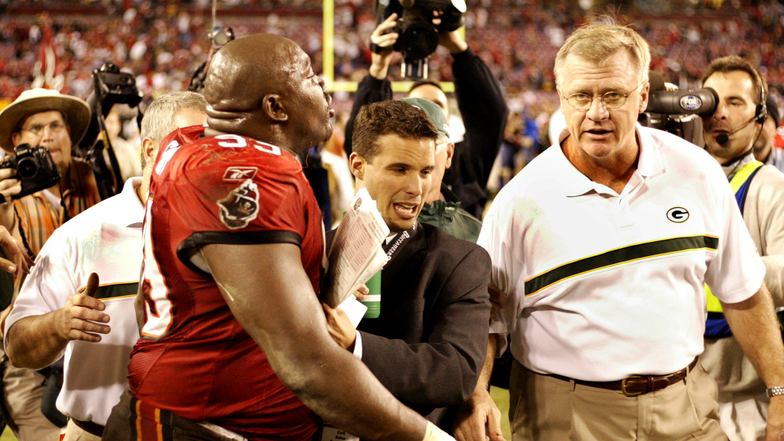 Mike Sherman and Warren Sapp exchange words after a Packers-Bucs game in 2002.