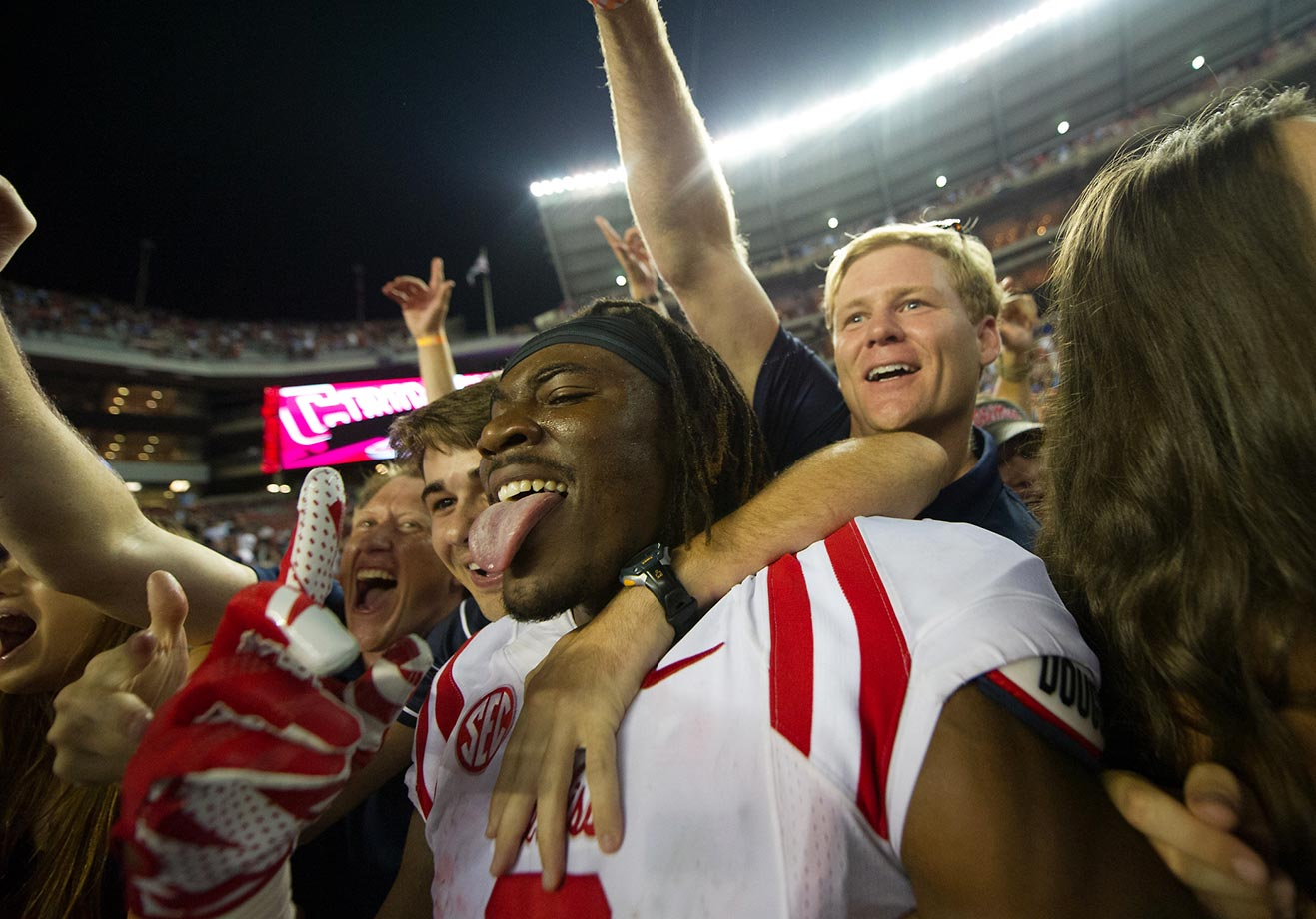Quincy Adeboyejo of Ole Miss celebrates with fans after the upset of Alabama.