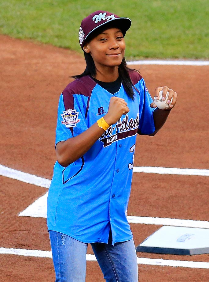 Little League Baseball pitcher Mo'ne Davis dances after she throws out the ceremonial first pitch before Game 4 of the World Series.