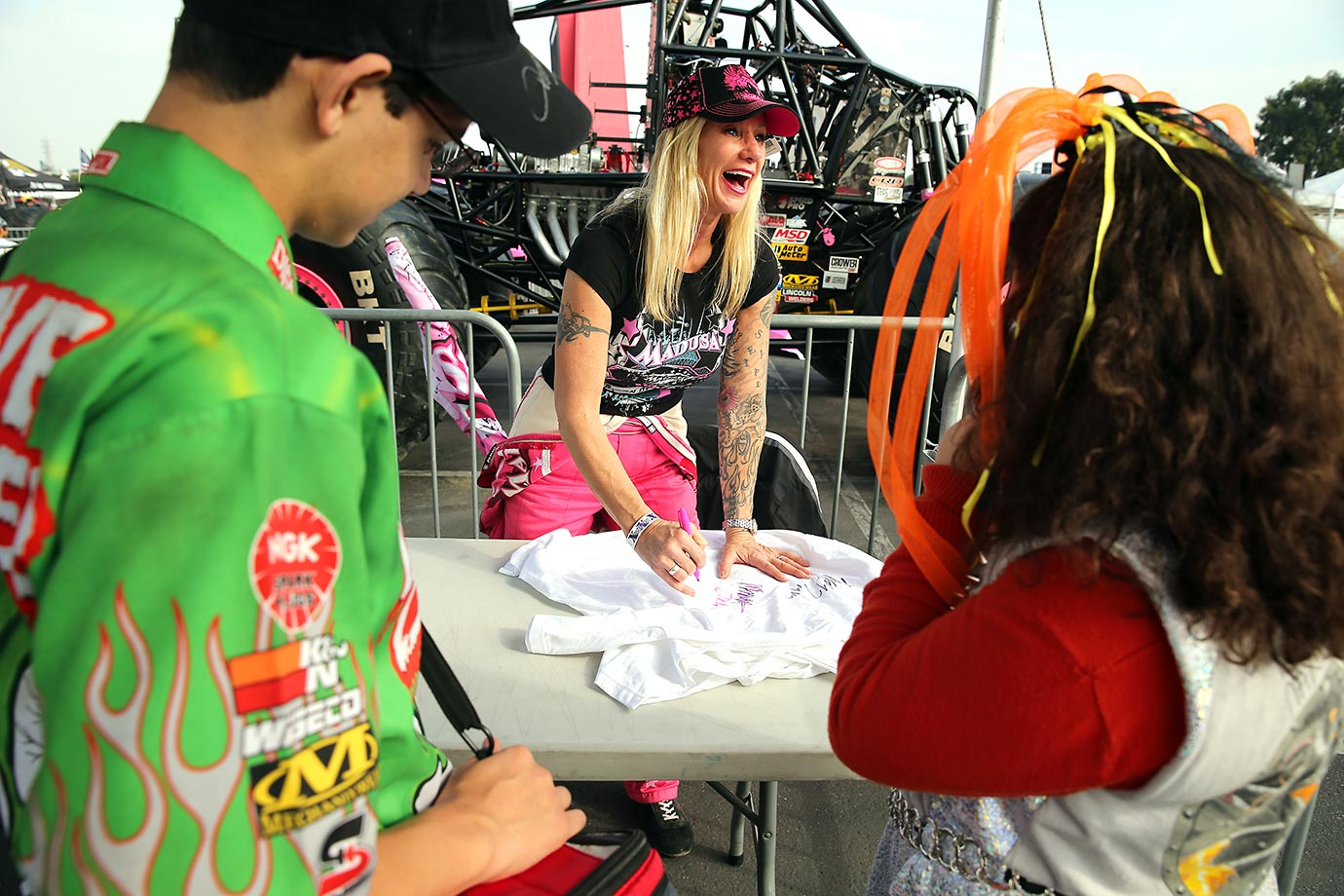Madusa and Monster Truck driver Debra Miceli sign autographs for fans. Before becoming a Monster Jam icon, Madusa was one of the most celebrated professional wrestlers in sports.